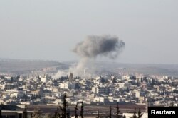 Smoke rises after air strikes by Syrian government forces in Anadan city, about 10 kilometers away from the towns of Nubul and Zahraa, in the northern Aleppo countryside on February 3.