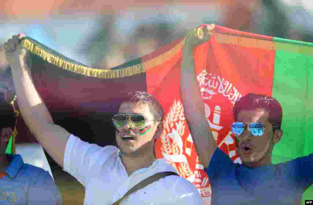 Afghan cricket supporters cheer for their team during the World T20 cricket tournament match between England and Afghanistan at the Feroz Shah Kolta Cricket Stadium in New Delhi on March 23.