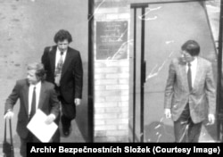 Anti-communist dissident Vaclav Havel (front left) seen leaving the Canadian Embassy with his brother Ivan, who wears a patterned tie.