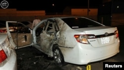 A damaged car is seen after a blast near the U.S. consulate in the Saudi city of Jeddah on July 4.