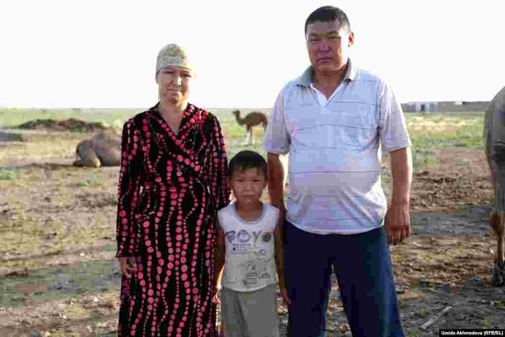 Zamira, a camel milkmaid, with her family. For the Kazakhs, the skills of camel breeding are a closely guarded secret.