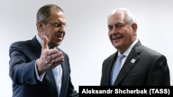 Russian Foreign Minister Sergei Lavrov (left) talks to U.S. Secretary of State Rex Tillerson on the sidelines of the G20 foreign ministers meeting in Bonn on February 16.