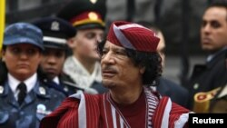 Libyan leader Muammar Qaddafi takes part in an official welcoming ceremony in Kyiv in 2008.
