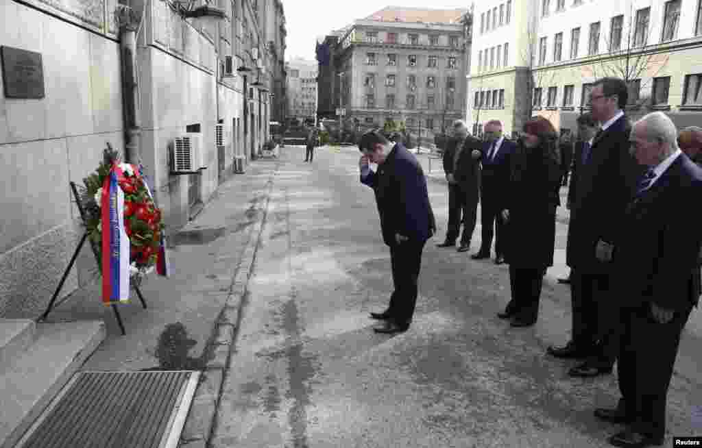Serbian Prime Minister Ivica Dacic (center) and members of the government pay their respects on March 12, 2013, in front of the Serbian government building where Djindjic was assassinated 10 years ago in Belgrade. (Reuters/Djordje Kojadinovic)