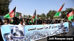 Members of Afghan Hazara community rally to demand the government bring security in Herat in September 2017.
