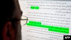 A journalist studies original documents recovered from Osama Bin Laden's compound that were released May 3 by the Combating Terrorism Center at the U.S. Military Academy.