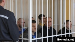Election opponents of Belarusian President Alyaksandr Lukashenka sit in the dock in a Minsk courtroom on May 11.