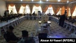 جانب من المؤتمر الذي عُقد في النجف لبحث الخطة الأمينة ليوم الانتخابات