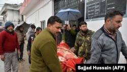 An injured man is carried on a stretcher at a hospital in the Indian-administered Kashmir's frontier town of Mendhar on March 2.