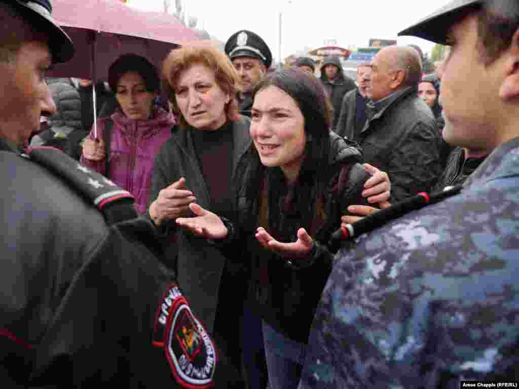 On a rainy, cold morning in Yerevan, protesters try to reason with police.