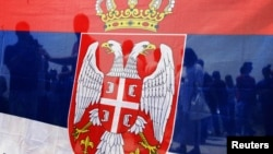 Kosovo -- Ethnic Serbs hold a Serbian national flag during an event to mark the anniversary of the 1389 Battle of Kosovo at Gazimestan, near the capital Pristina, 28Jun2013