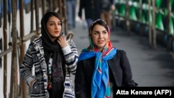 Iranian women wearing hijabs on a street in the capital, Tehran.