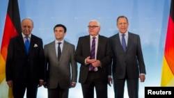 Главы МИД Германии, Франции, Украины и России - Франк Вальтер Штайнмайер, Лоран Фабиус, Павел Климкин и Сергей Лавров (слева направо) на встрече в Берлине (2 июля 2014 года)