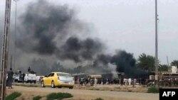 Pamje pas një eksplodimi të mëparshëm në Bagdad