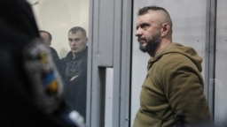 One of the five suspects in the murder case of journalist Pavel Sheremet, Andriy Antonenko, appears in court in Kyiv on December 13.