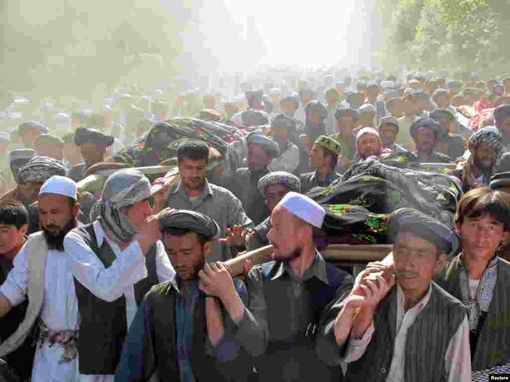 Afghans carry the bodies of people killed after a raid by NATO and Afghan forces, during a protest in Taloqan. Ten people were killed and 50 wounded in violent protests against the killing of two men and two women in a nighttime raid in northern Afghanistan.Photo by Reuters