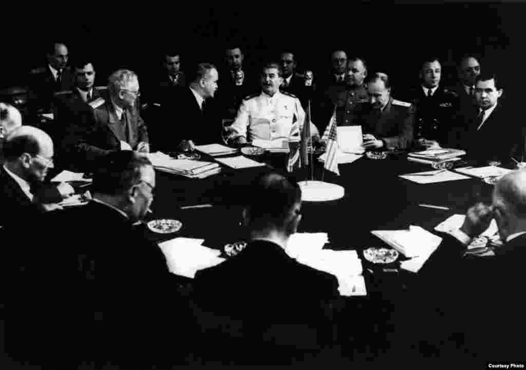 Josef Stalin (in white) sits among aides and advisers at Potsdam in July 1945
