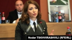 Georgia's Prison Minister Khatuna Kalmakhelidze is stepping down amid claims of prison abuse.