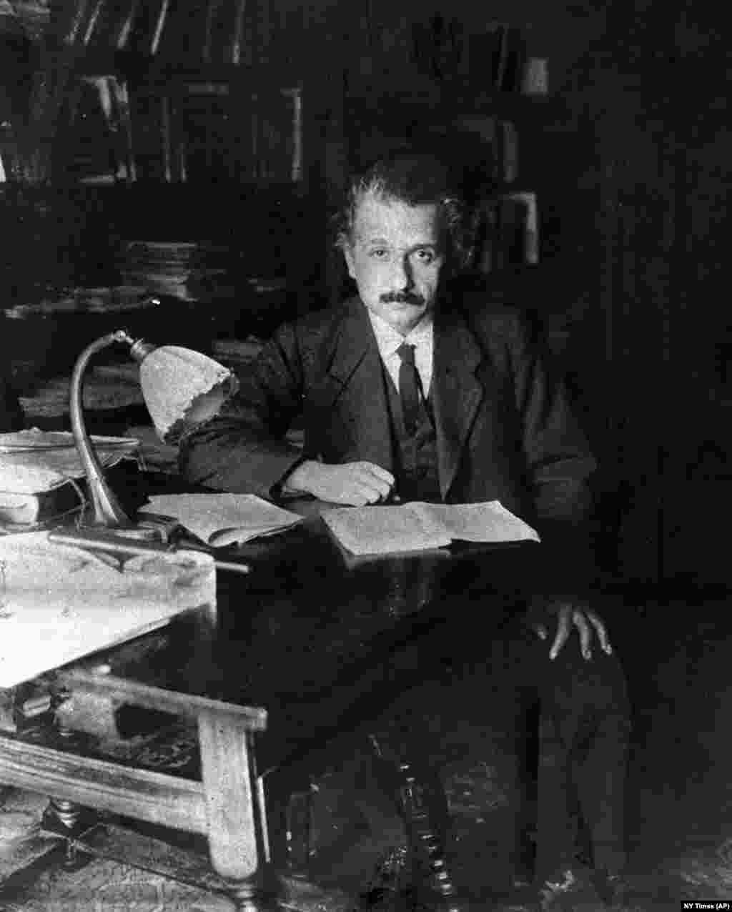 Albert Einstein poses in his study in Berlin in 1919 when he was 40 years old. Although recognized in scientific circles, Einstein would become a household name only after receiving the Nobel Prize for Physics in 1921.