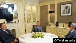 Presidents Dmitry Medvedev (center), Ilham Aliyev (left) and Serzh Sarkisian meet in Moscow on July 18.