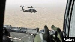Ауғанстанның Гильменд провинциясын әуеден бақылап жүрген АҚШ әскери тікұшағы. 5 сәуір 2011 жыл.