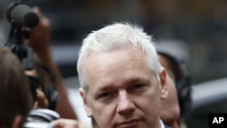 WikiLeaks founder Julian Assange was surrounded by reporters as he arrived in Britain's Royal Courts of Justice for his extradition appeal in central London in July.