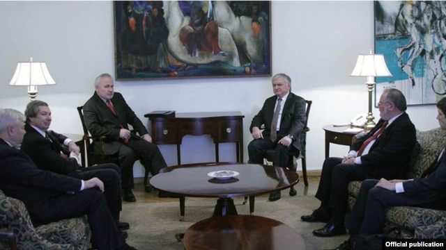 Armenian Foreign Minister Edward Nalbandian (center-right) meets with the OSCE Minsk Group co-chairs in Yerevan on December 16.