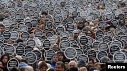 "Protesters gather in front of the ""Agos"" newspaper office during a demonstration to mark the fifth anniversary of the killing of Turkish-Armenian editor Hrant Dink in Istanbul in January 2012."