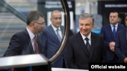 Uzbekistan President Shavkat Mirziyoev (second-right) visits a factory owned by Texnopark, which has controversially won a tender for installing millions of gas meters.