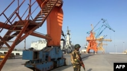 A Pakistani soldiers guarding port cranes in Gwadar, a seaport in Balochistan.