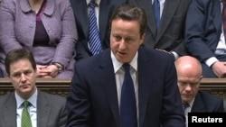 Ұлыбритания премьер-министрі Дэвид Кэмерон парламентте мәлімдеме жасап тұр. Лондон, 18 наурыз 2011 жыл.
