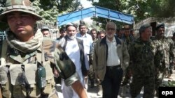 Abdul Jabar Taqwa (center, in white shirt and black trousers), the governor of Takhar Province, seen on a district visit in June 2010