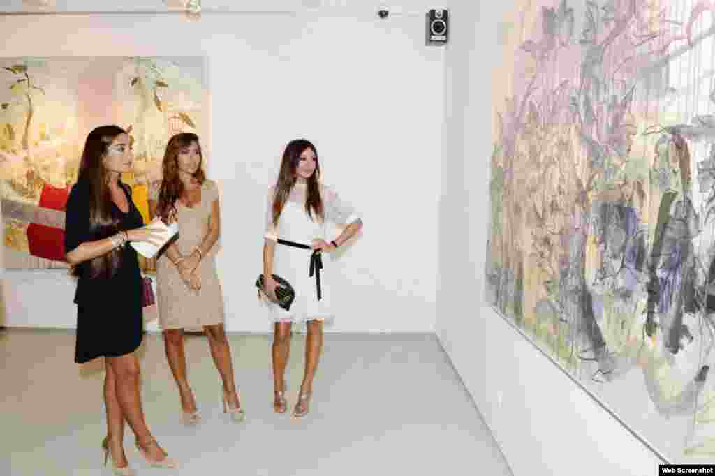 Lela Aliyeva (left), a daughter of Azerbaijan's current president, and Mehriban Aliyeva (right), the president's wife, with an unidentified woman viewing an art exhibition in Baku. The exhibition is titled  Internal Peace.