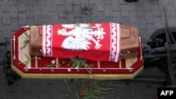 The casket of late President Lech Kaczynski on its way from the presidential palace to the St.John cathedral in Warasw on April 17.