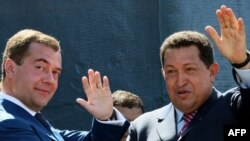 Venezuelan President Hugo Chavez (right) and his Russian counterpart, Dmitry Medvedev in November during Chavez's trip to Moscow