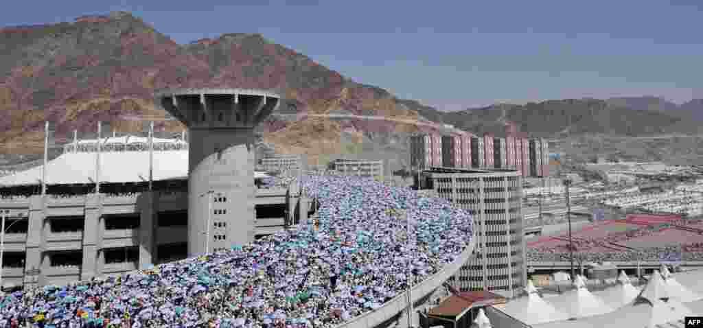 Pilgrims arrive to throw pebbles at pillars during the Jamarat ritual in Mina near the holy city of Mecca, during the 2012 hajj.