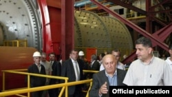 Armenia - Prime Minister Tigran Sarkisian (R) and Maxim Hakobian, CEO of the Zangezur Copper-Molybdenum Combine, visit the company's ore-processing plant in Syunik, 10Sep2011.