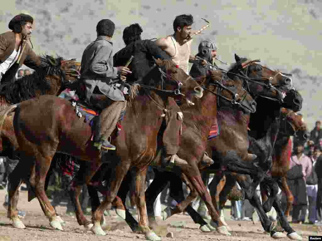 Afghan horsemen compete during a game of buzkashi in Kabul on December 3. The Afghan national sport is played between two teams of horsemen competing to pick a headless calf, goat, or sheep carcass from the ground and throw it into a scoring circle. Photo by Omar Sobhani for Reuters