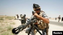 Ирак жасағы сарбазы. 16 маусым 2014 жыл.