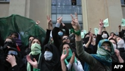 Opposition supporters demonstrate at Tehran University in December 2009.