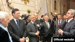 Armenia -- President Serzh Sarkisian (R) meets with prominent members of France's Armenian community in Paris, 10 March 2010.