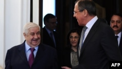Russian Foreign Minister Sergei Lavrov (right) speaks with his Syrian counterpart, Walid al-Muallem, during their meeting in Moscow.