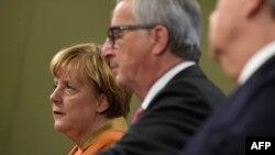 Angela Merkel și Jean-Claude Juncker