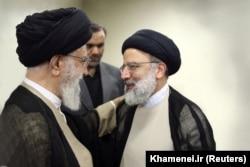 Iranian Supreme Leader Ayatollah Khamenei (left) with Ebrahim Raisi (file photo)