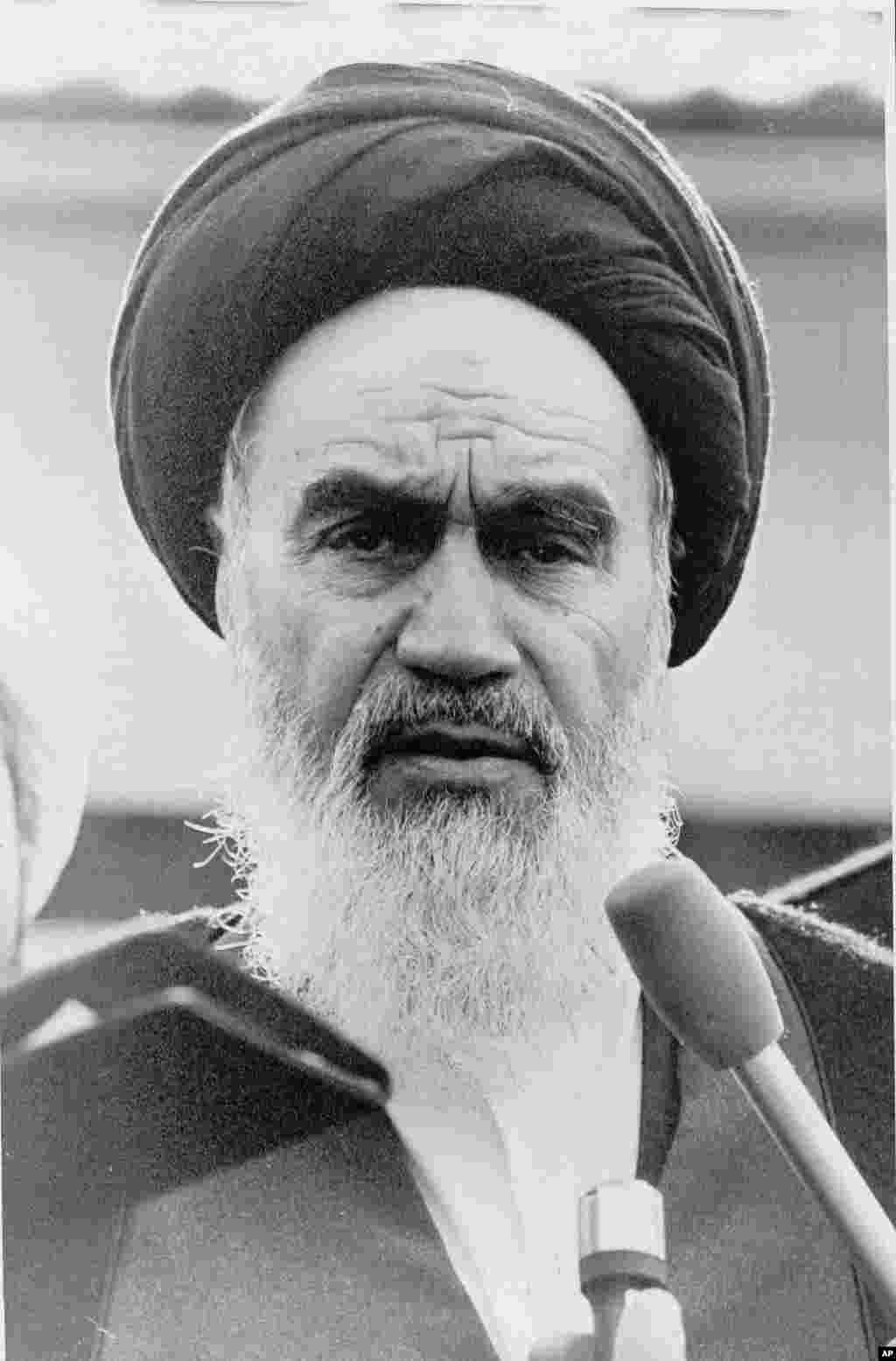 Ayatollah Ruhollah Khomeini, Iran's exiled religious leader, speaks on January 25, 1979, at a news conference following morning prayers in Paris. Through an interpreter, he told international journalists that he was postponing his return to Tehran because of the Iranian Army's closure of the airports.