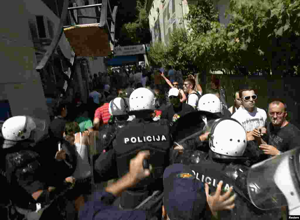 Police clash with protesters during the gay-pride parade in Budva.