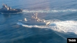 A photograph released by Russia's FSB security agency apparently showing an altercation between Russian and Ukrainian ships off the coast of Crimea on November 25.