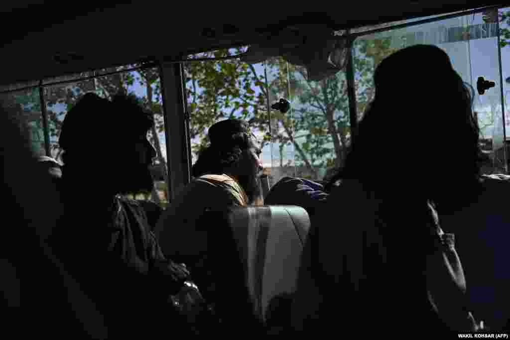 Taliban prisoners sit inside a vehicle during their release from Bagram prison.