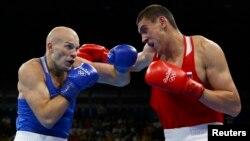 Evgeny Tishchenko (right) of Russia upset Vassiliy Levit of Kazakhstan to win the gold.
