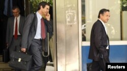 IMF and EU officials leave the Greek Finance Ministry amid talks on a bailout deal.